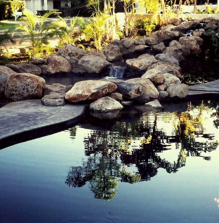 Water feature reflecting pool with waterfall and rocks in Maui, HI