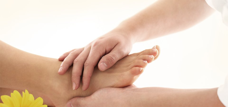 A lady having a foot examination