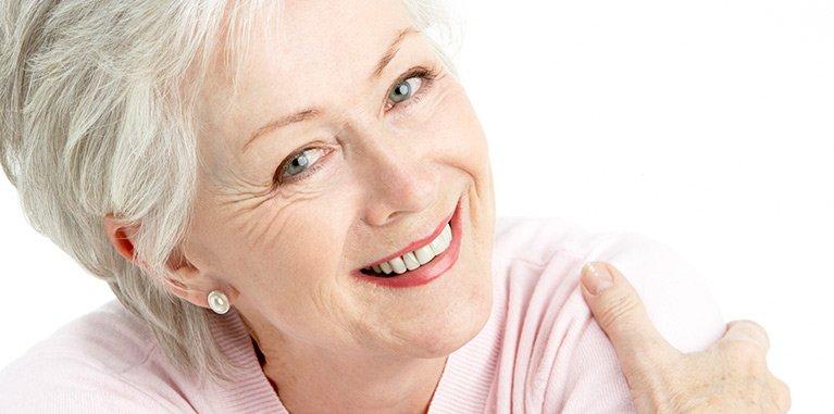 Woman who has dental bridges in Chermside