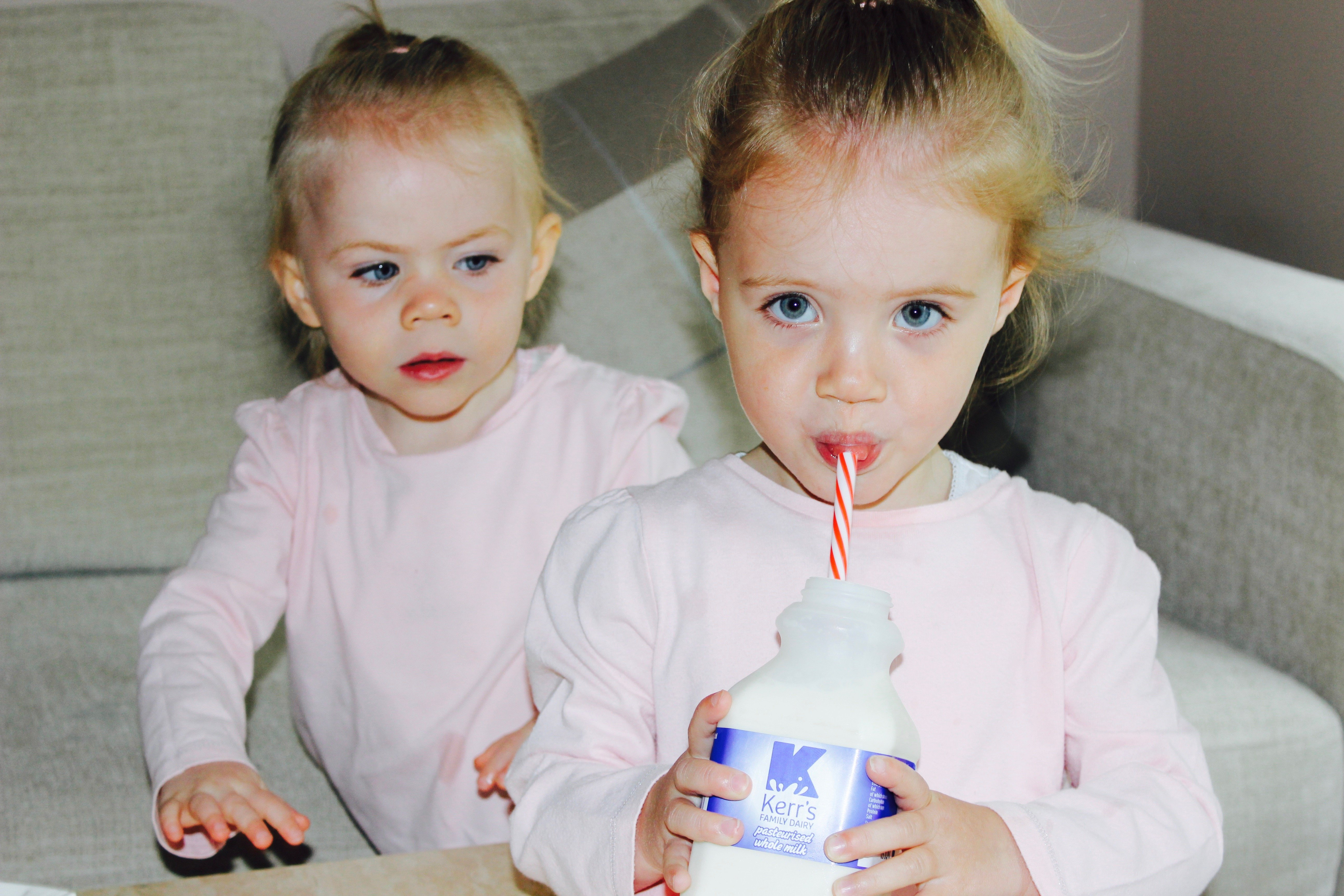 kids posing with milk bottle