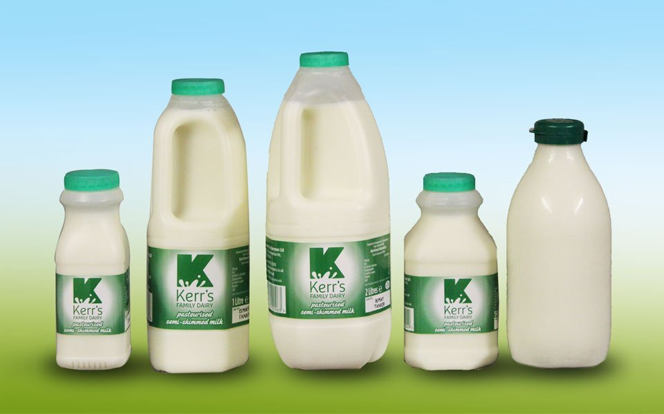 varied sized milk bottles