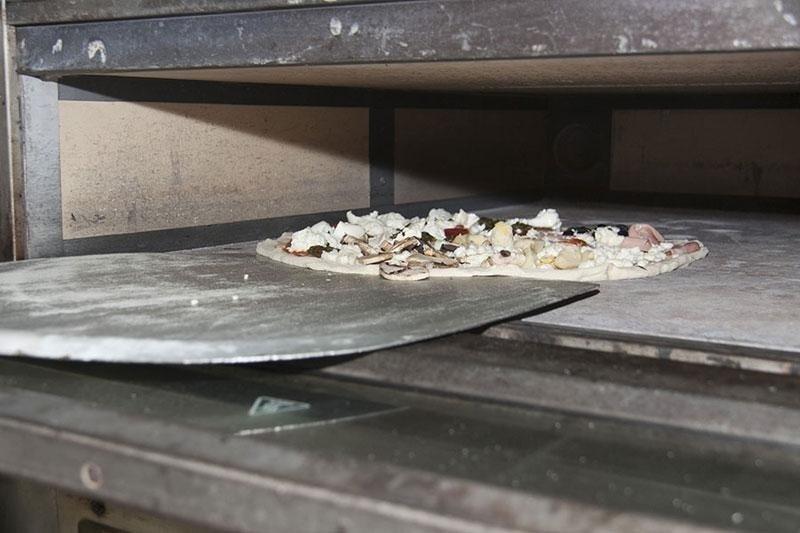 infornare pizza