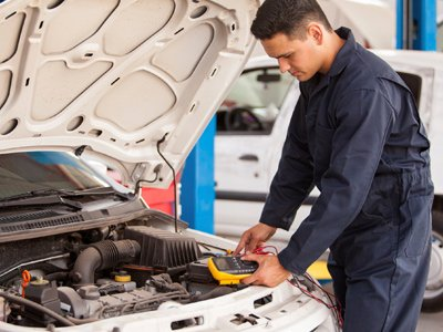 chriss automotive and marine electrics mechanic checking battery