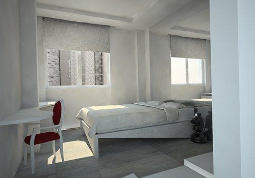 una stanza con un letto matrimoniale e una sedia in velluto bordeaux