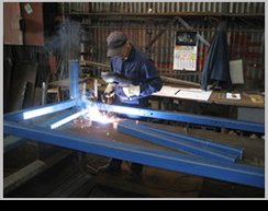 Technician working on custom metal fabrication in Russell Vale