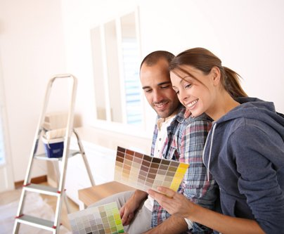 Couple selecting the paint colors from the chart provided by the premier painting team in Hamilton