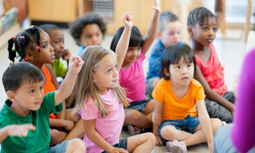 kids raising their hand