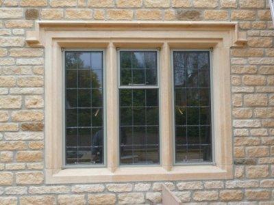 Three-light mullion window