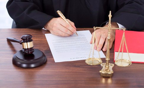 Attorney signing a legal document in New York