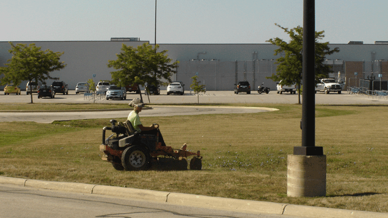 Power sweeper truck cleaning a parking lot