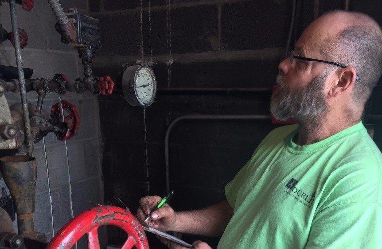 Dublin CPS, Inc. technician performing a mechanical inspection.