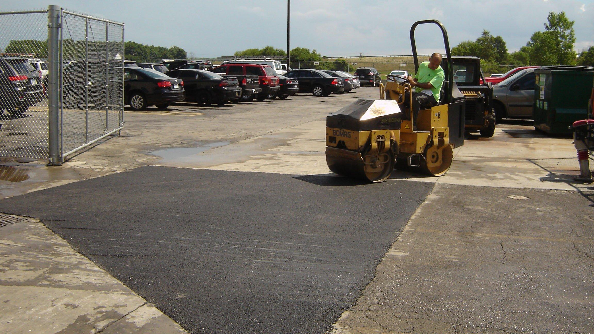 Dublin CPS, Inc. finishing an asphalt repair job in an Ohio industrial area