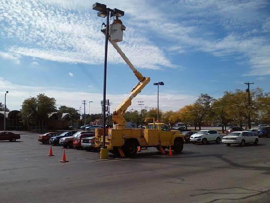 Dublinc CPS, Inc. performing lighting repair on parking lot pole light