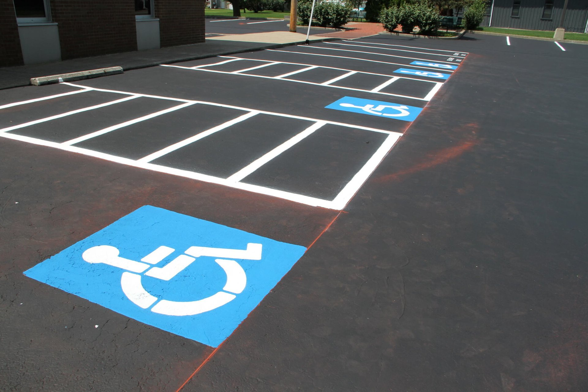 A finished parking lot striping job with handicap spaces and no parking zones performed by Dublin CPS, Inc. in Ohio