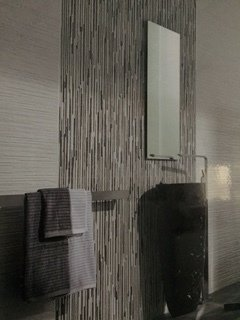 Bathroom showroom with tiled wall