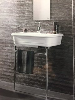 Tiled bathroom with sink and mirror