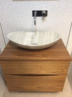 Sink in bathroom with tiles walls