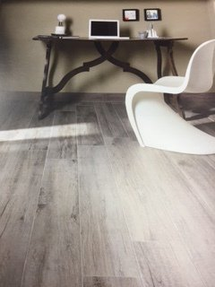 Wooden-effect flooring in a study with desk and chair