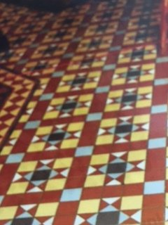 Multi-coloured tiles in mosaic pattern