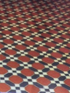Red, white and black mosaic tile pattern