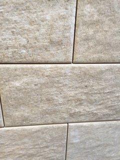 Grey textured wall tiles