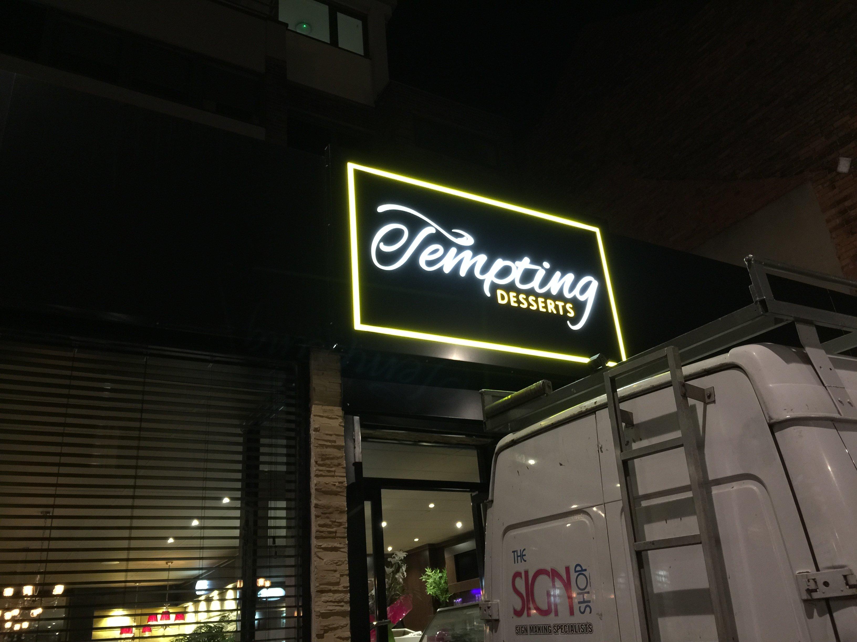 tempting desserts sign