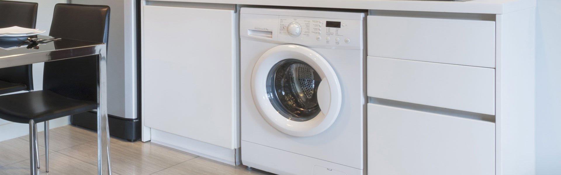 white coloured  washing machine