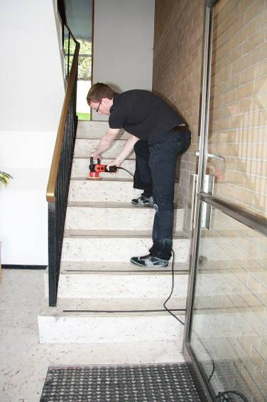 man cleaning the stairs