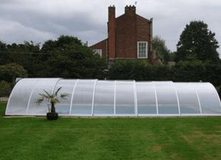 A long Arcus Original pool enclosure