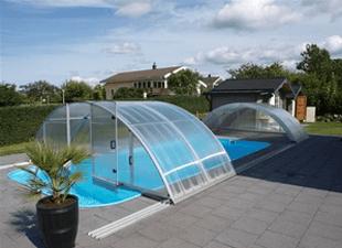 A half open Arcus Original swimming pool enclosure