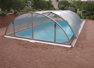 View of Arcus Original pool enclosure in garden