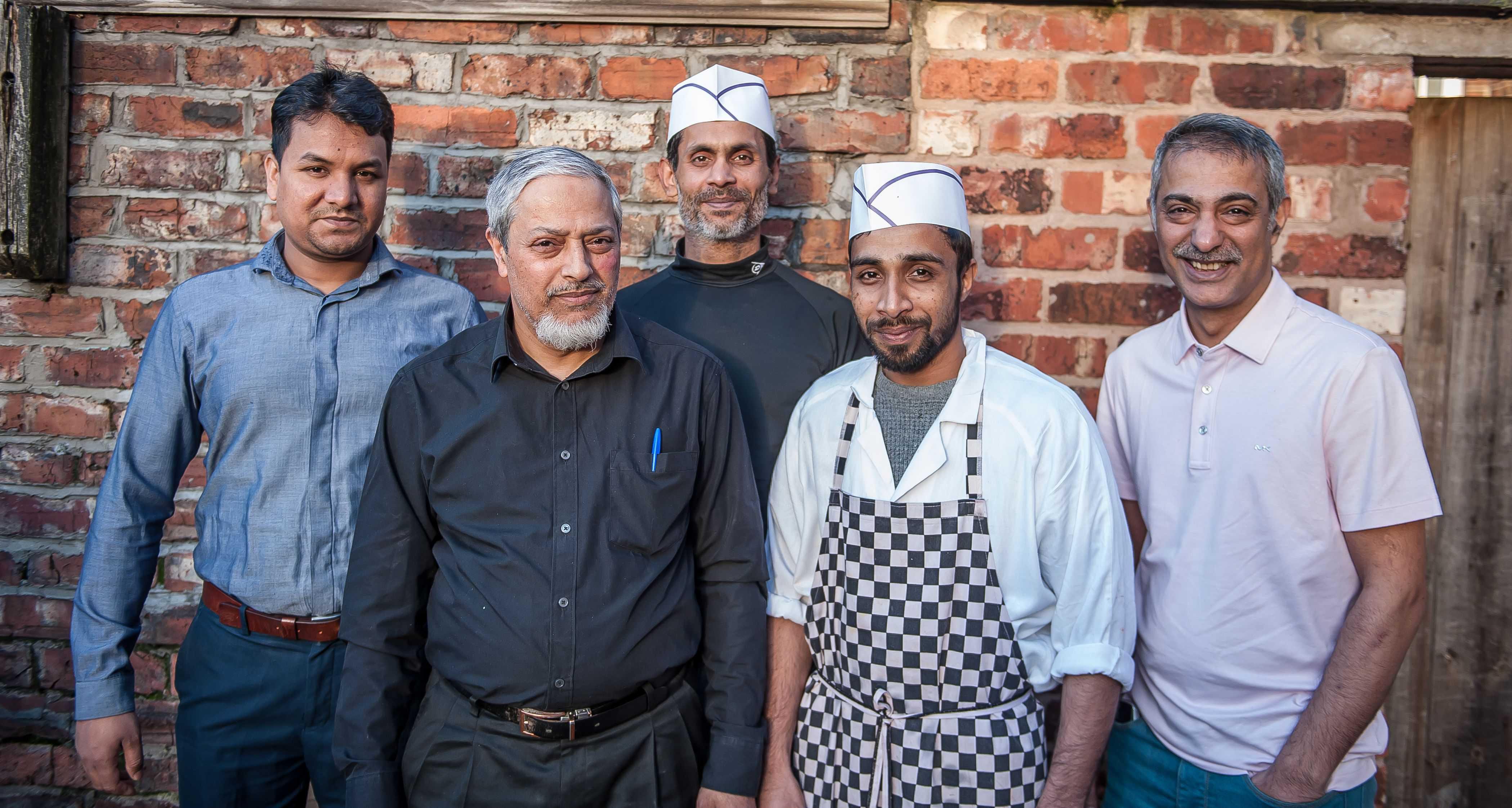 Tarik Syed and his staff at The Princess of Hearts