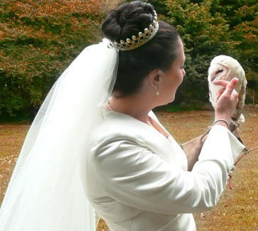 Bride holding white owl