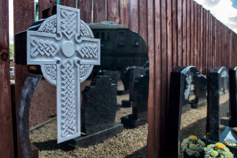 a memorial with a cross carved on it
