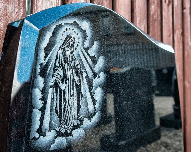 a memorial with mother Mary painting