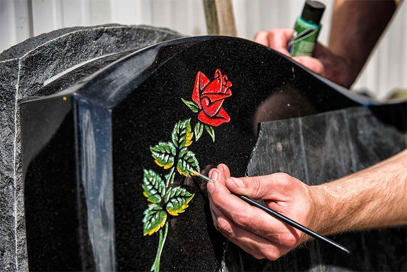 a memorial with a rose painting