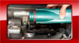 meccanici in sede, controllo gas di scarico, riparazioni auto