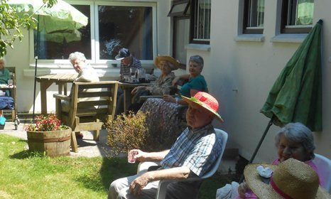 group of people sitting in the garden
