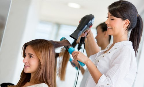 Blow dry of women hair by professional
