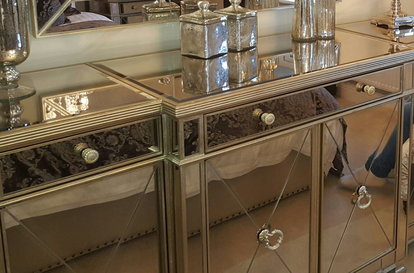Drawers and cupboards with mirrored tops and doors