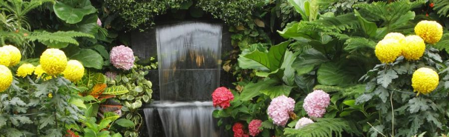 Beautiful garden and waterfall built by our landscaping company in Anchorage, AK