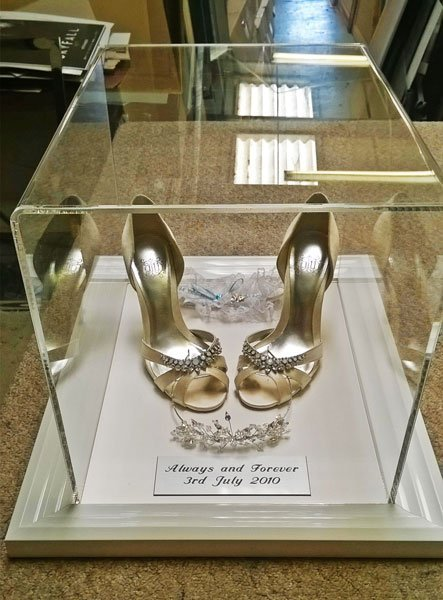 shoes in acrylic box