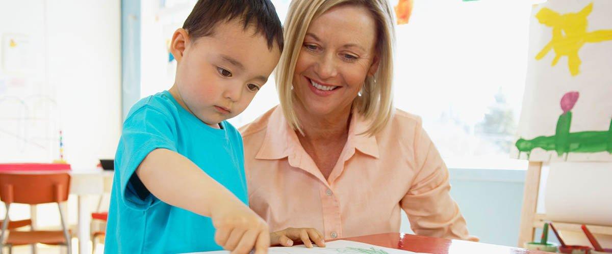 nursery staff with a kid