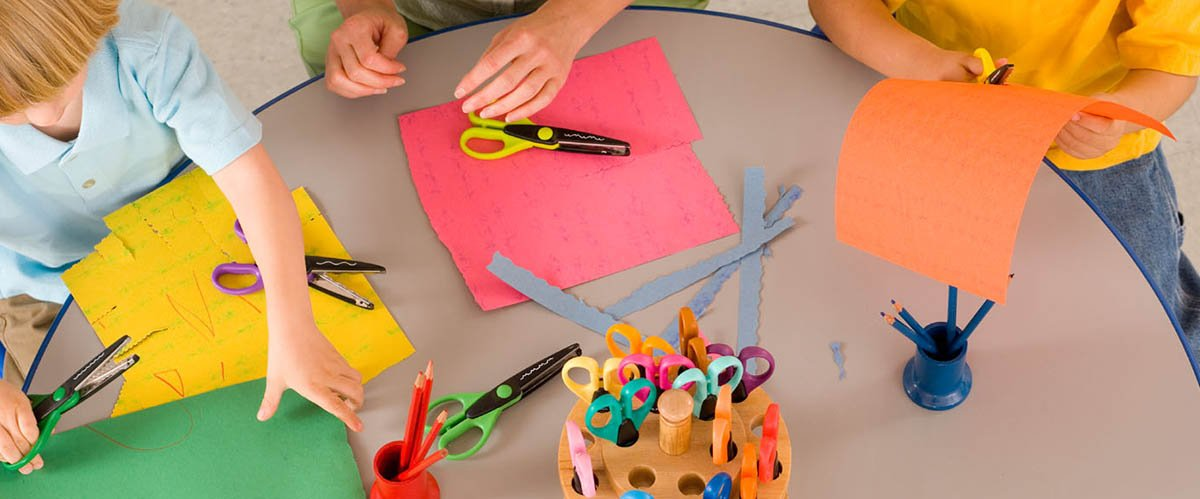 cutting the coloured paper