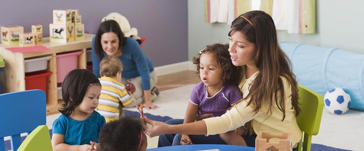nursery staff with children