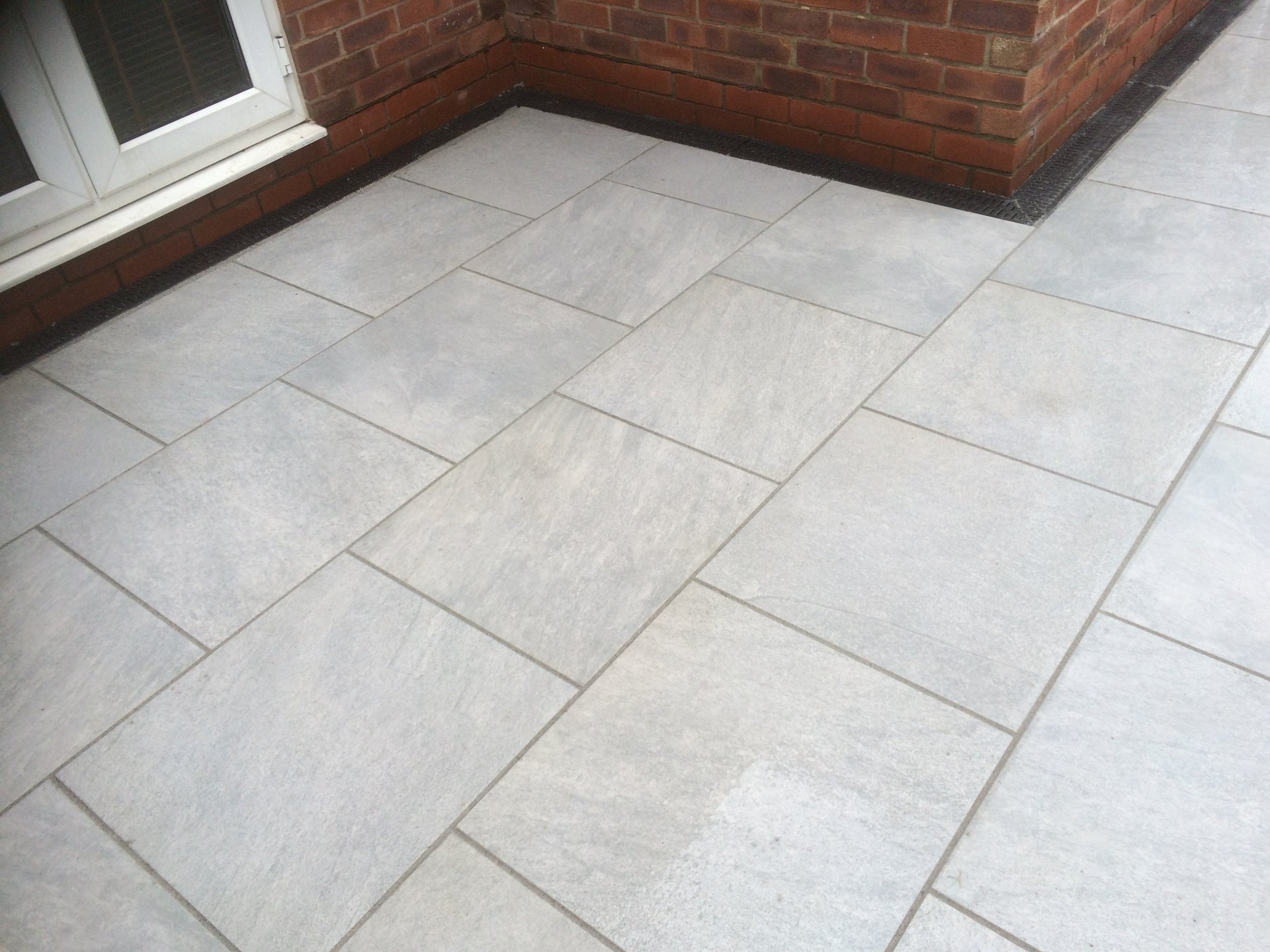 white coloured driveway tiles