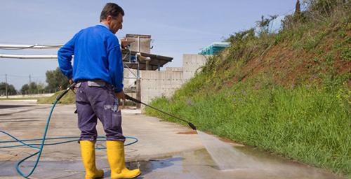 Technician providing asphalt service to a property in Edwards, CO