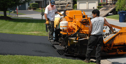 Professional using equipment for providing mountain maintenance and asphalt services in Edwards, CO