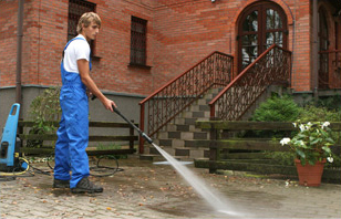 Professional providing asphalt cleaning services in Edwards, CO