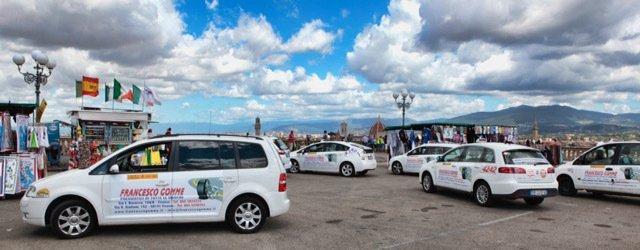 Mezzi aziendali bianchi dell'officina Francesco Gomme, su sfondo di cielo azzurro
